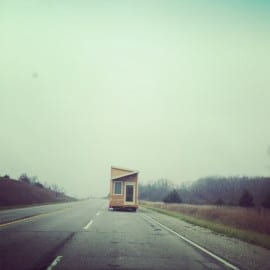 tiny house on a big road