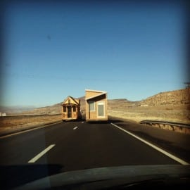 Two tiny houses passing on the highway!