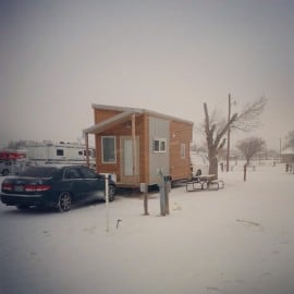 tiny house in snowstorm