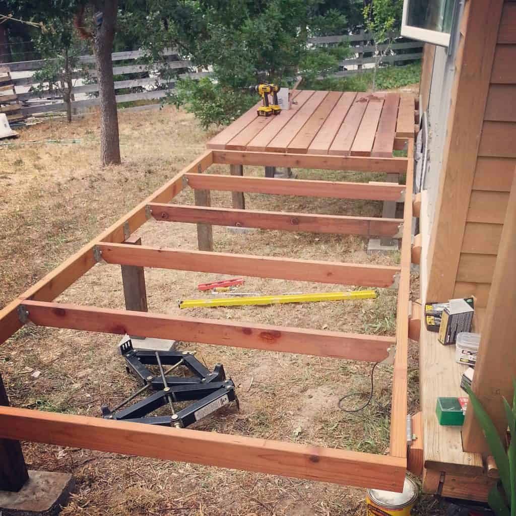 tiny houses are better with folding redwood decks. Black Bedroom Furniture Sets. Home Design Ideas