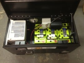 A smaller custom SolMan power box, showing batteries, inverter and solar controller
